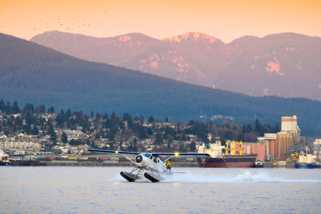 A white Harbour Air seaplane prepares for takeoff from the Fraser River in Vancouver, Canada.